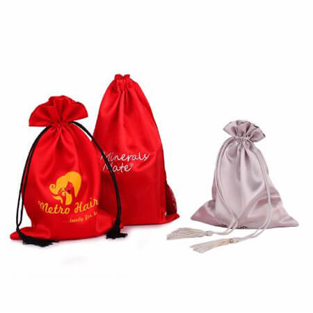 Satin pouch with tassels 1